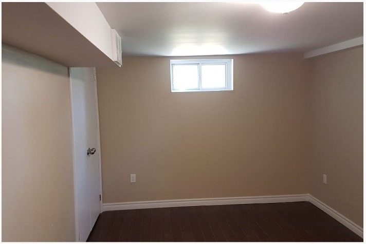 Spacious bedroom 2 with plenty of natural light (2 windows) and closet