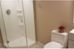 Totally renovated washroom with new vanity and toilet seat plus stackable washer  dryer